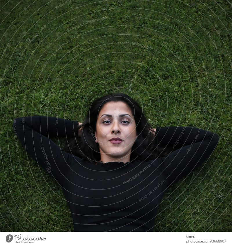 Estila Woman Meadow Lie Earnest Looking look Black conceit Long-haired Observe Skeptical Meditative recover Break Nature out Upper body Interlocked