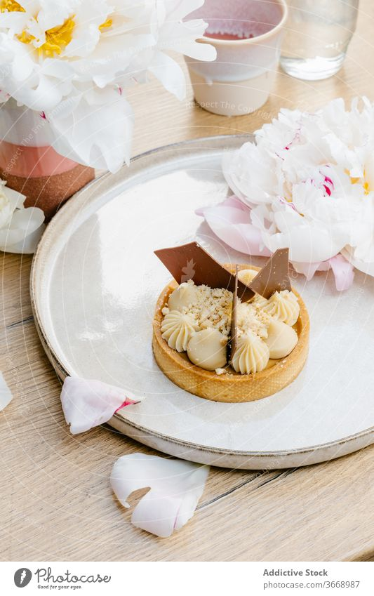 Delicious caramel tart with chocolate dessert sweet garnish waffle cone flower treat white chocolate palatable delicious food tasty pastry fresh yummy tray