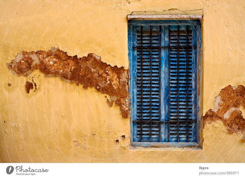 zanzibar prison island and a old Blue Old White Black Yellow Line Brown Door Historic Grating Light blue Zanzibar