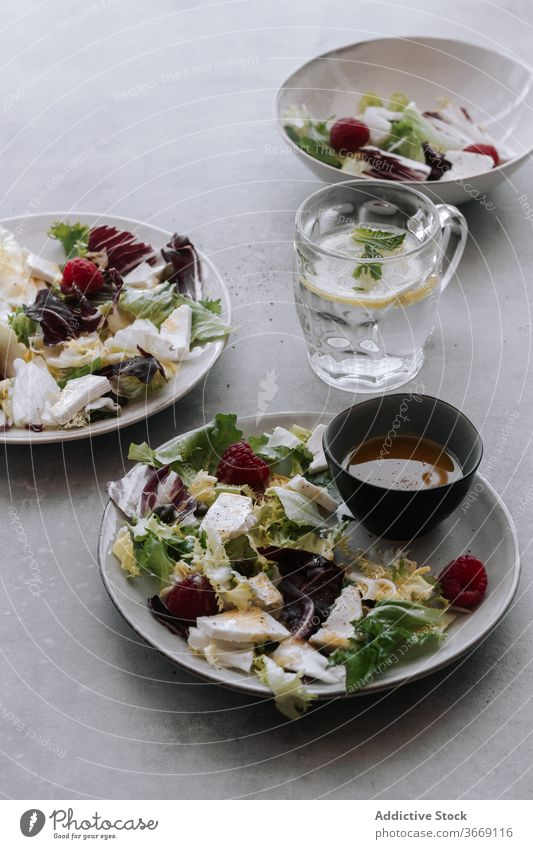 Fresh salad with berries and vegetables fresh summer mix cabbage lettuce raspberry healthy delicious food water lemon arrangement composition meal diet dish