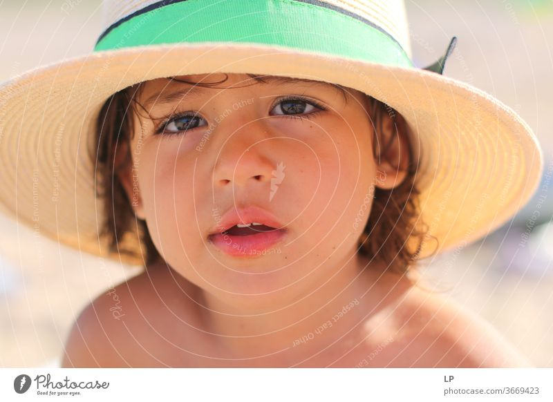 little girl wearing a hat Hat brim Girl Child Straw hat Exterior shot Summer Colour photo Human being Infancy Relaxation Vacation & Travel Nature