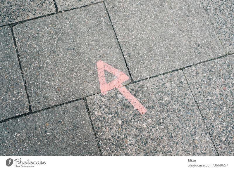 Red arrow pointing left up on asphalt Arrow Direction Asphalt Above Left Orientation Turn off make a turn to the left Forwards Navigation Road marking