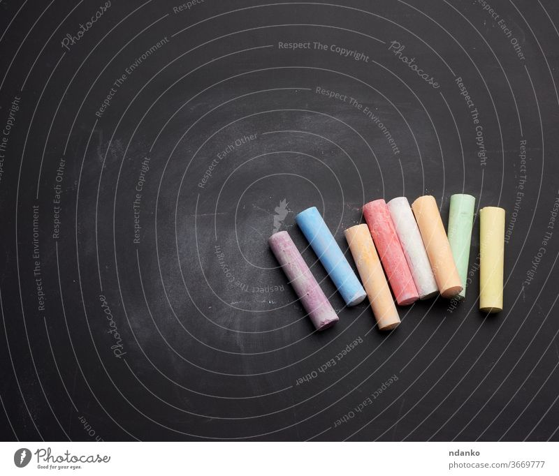 multicolored chalk on lie on empty black chalk board stick clean piece ad advertisement art background billboard blackboard blank chalkboard class classroom
