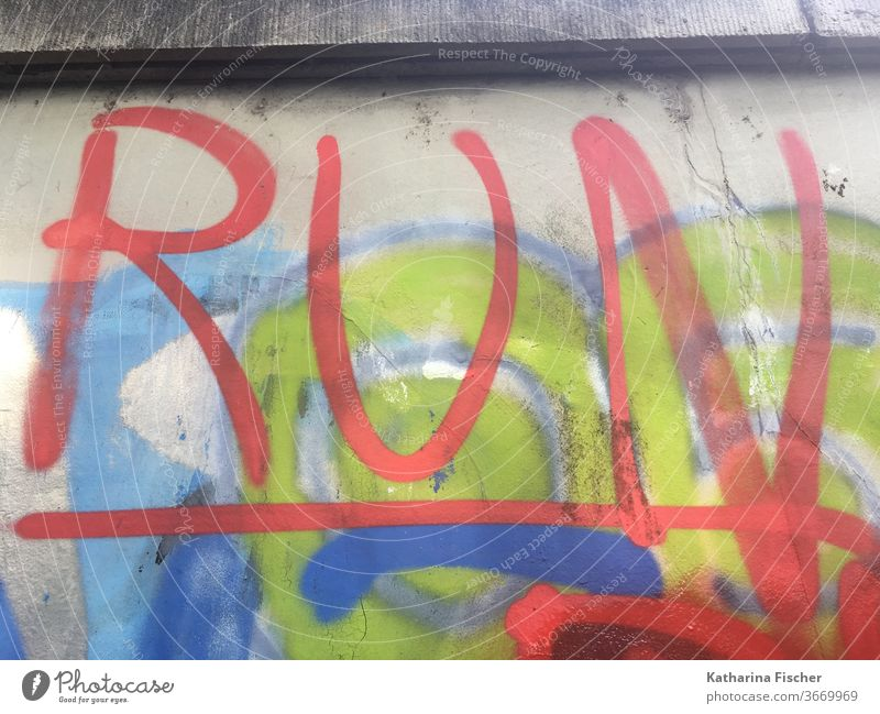 RUN - Graffiti - House wall Wall (building) Wall (barrier) Exterior shot Colour photo Characters Deserted Day Facade Town Sign Red green Blue run invitation