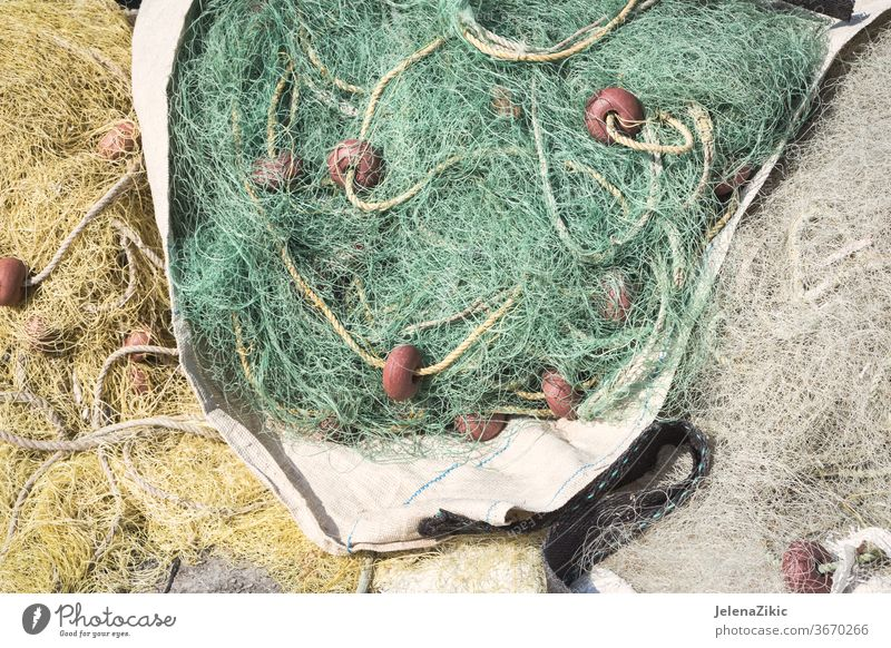 Fishing nets on the waterfront after fishing day detail nobody rope sea fisherman boat netting fishing net ocean marine textured equipment floater rough nylon