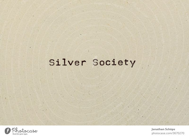 Silver Society as text on paper with typewriter Age group Mileu Paper Recycling Pensioners Typewriter writing silver society typography Old Analog English Retro