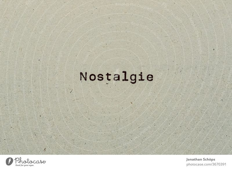 Nostalgia as text on paper with typewriter Paper Recycling recollection Review Typewriter writing typography Analog Former Retro Text Copy Space vintage Vintage