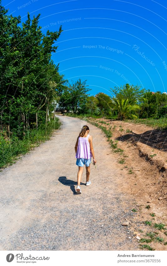 Small girl walking on a stone path in an environment surrounded by natured hill exercise healthy man training mountain workout summertime trekking sunlight calf