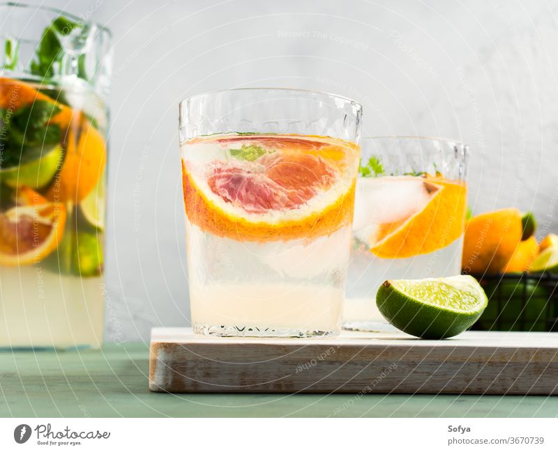 Fresh summer citrus drink water cocktail lemonade infused detox blood orange lime fruit juice mocktail mint soda sweet home made slice healthy green pastel pink