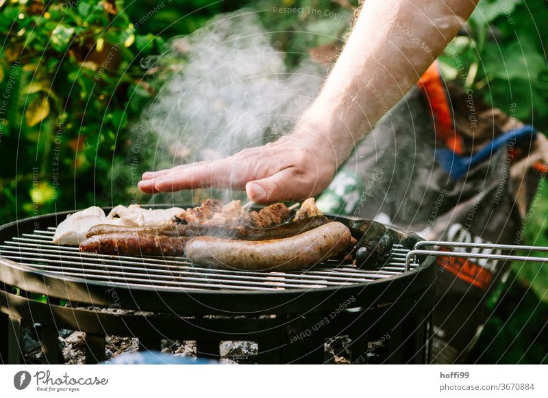 the little temperature check on the barbecue-- it's gonna... BBQ by hand charcoal grill Small sausage barbecue food grilled meat Barbecue (apparatus) Nutrition