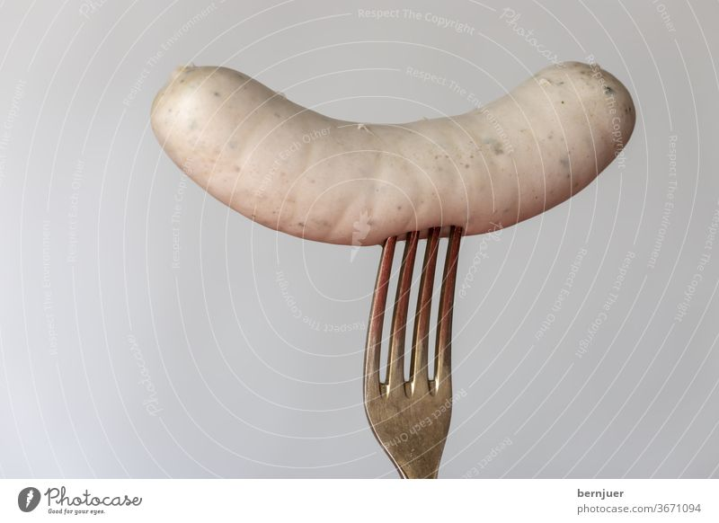 Bavarian veal sausage on white background Veal sausage segregated Silver Fork Individual White Meat traditionally Meal Eating Munich cake Oktoberfest Breakfast