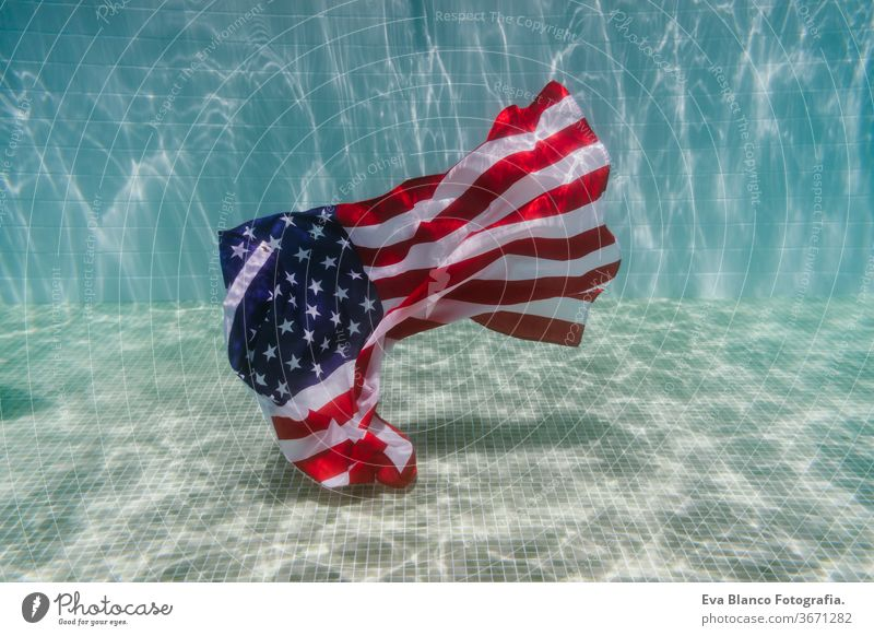 american flag underwater in a pool. 4th july concept, independence day. Nobody fourth july united states swimming pool summer ripple us country signs star wave