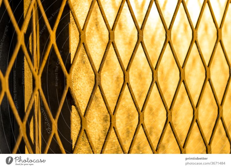 Closeup on heavy metal security grate abstract texture background. Background aluminum architecture backdrop building construction design dirty door exterior