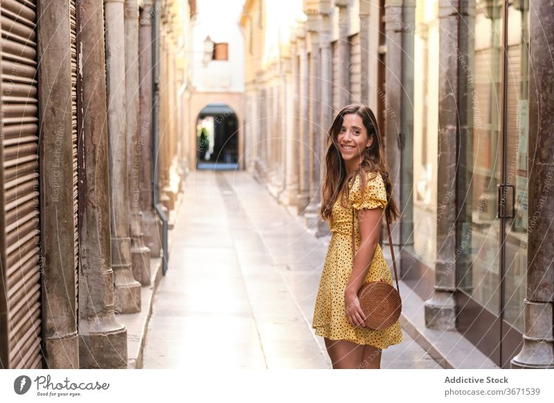 Charming woman walking along street city stroll enjoy weekend content summer charming female happy style trendy smile young urban delight positive lady glad