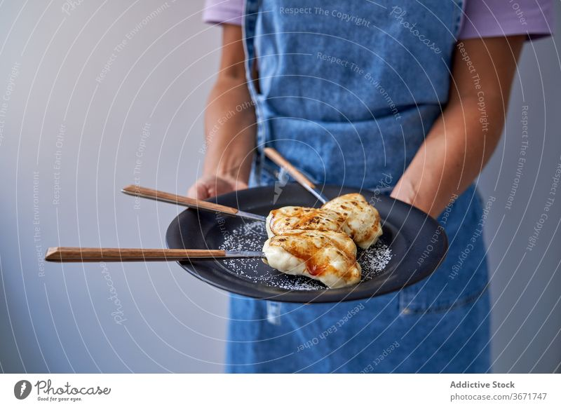 Crop woman with portions of creme brulee on plate dessert delicious sugar cook homemade tasty baked female sweet pastry apron food gourmet meal cuisine lady