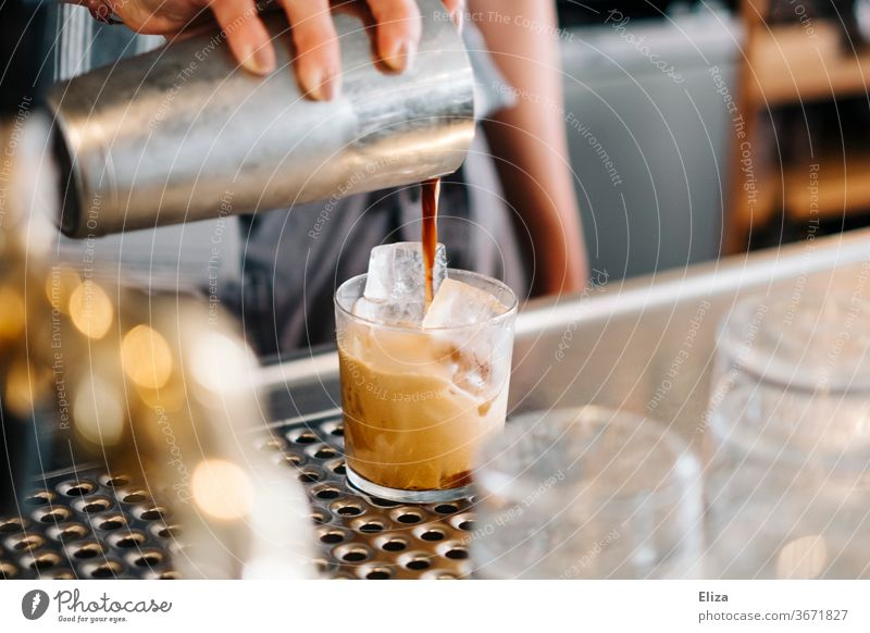 Preparation of a cold mixed coffee on ice Coffee chill Iced coffee shaked Caffé Freddo Bear Café Gastronomy Beverage Summer Caffeine Shakerato Cast shaker Glass