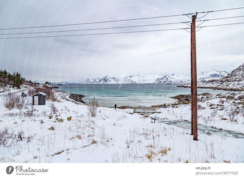 Snow landscape at a bay on the Lofoten Lofotes Lofoten Islands Norway Scandinavia Winter chill Snowscape Ocean River Ice Bay Beach Rock vacation voyage