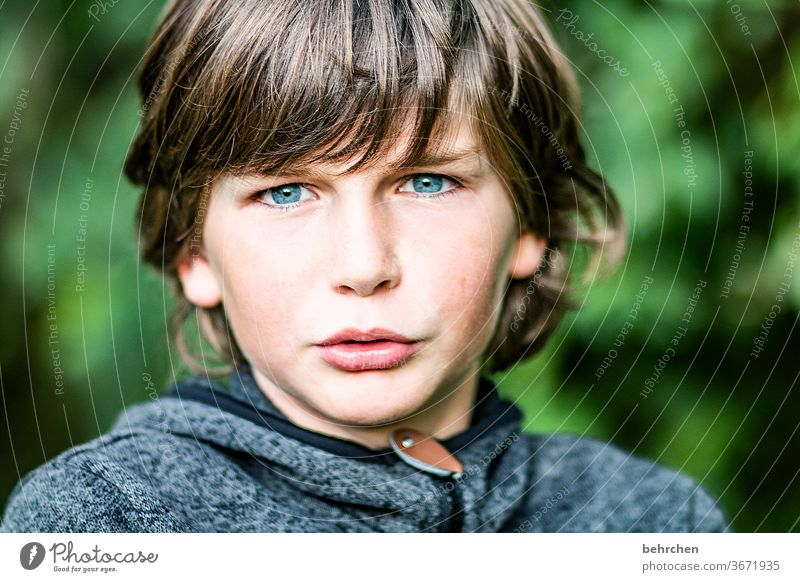 1 0 !!! Cool (slang) Brash long hairs Colour photo Family Close-up Child Boy (child) Infancy Face Day Light Contrast portrait Sunlight Hair and hairstyles Mouth