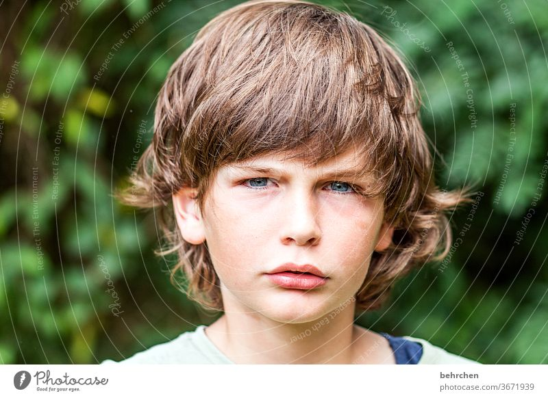 Mat Cool (slang) Brash long hairs Colour photo Family Close-up portrait Contrast Light Day Face Infancy Boy (child) Child Sunlight Hair and hairstyles Mouth