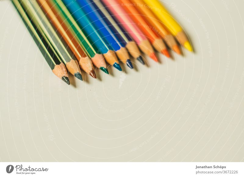 coloured pencils in all colours on white background made of paper graphic crayons First day at school first school day surface Free space Elementary school