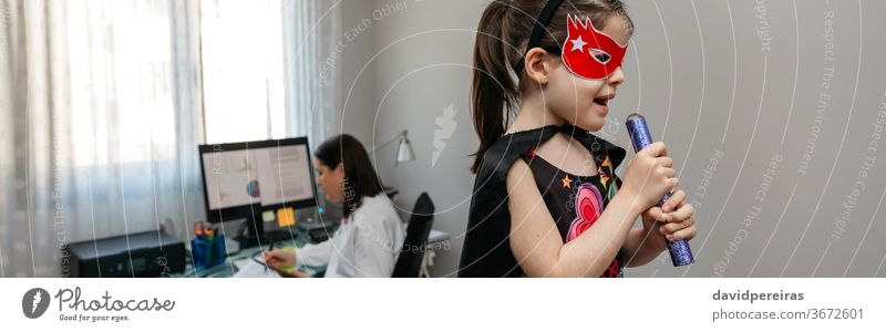 Girl singing in disguise while her mother teleworking work family reconciliation pajama pants home office daughter funny playing dancing banner web header