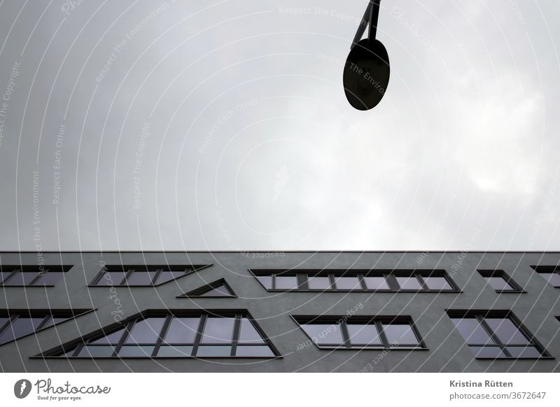 modern building and a lantern with a grey cloudy sky House (Residential Structure) built Architecture Modern Facade Office building Window Town urban