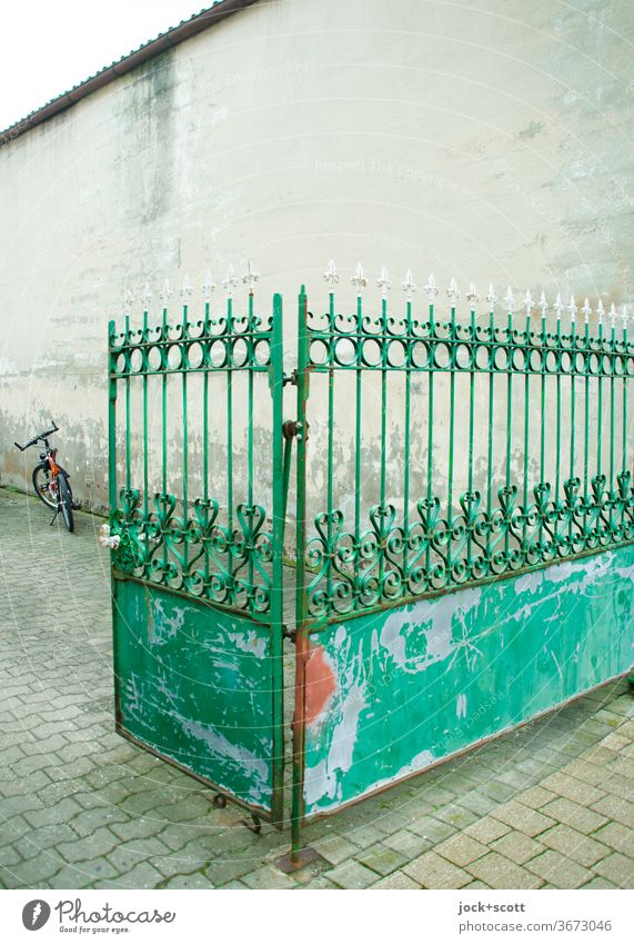 a proven gate for the entrance Fence Highway ramp (entrance) Bicycle Goal Highway ramp (exit) Old Weathered battered Wall (building) Stone slab metal gate