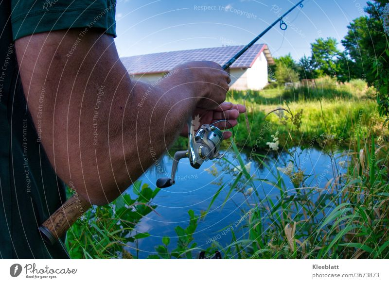 Angler is setting up his rod. Fish Water Fishing industry River River bank Fisherman Fishing (Angle) Colour photo Exterior shot Leisure and hobbies Fishing rod