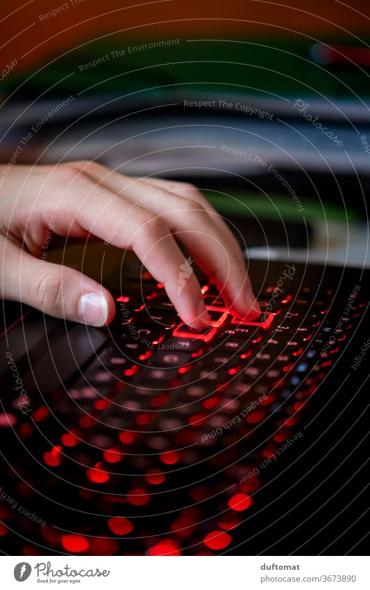 Hand on illuminated computer Keyboard Computer Computer games Computer user teenager gamer Playing Internet homeshopping Online Online store gamble Illuminated
