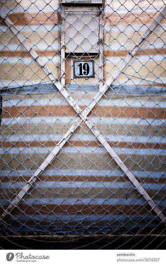 Sweet little 19 door Fence Wire netting fence too Closed number House number digit Lettering writing typography Stripe Screening Goal garden door Garden door