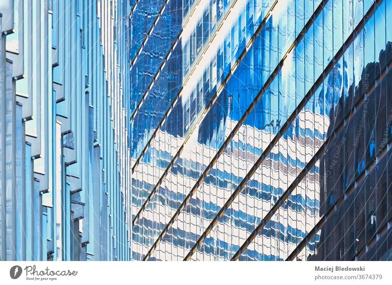 Modern buildings facades abstract architecture background. window skyscraper wall New York city office apartment real estate tower high day modern USA NYC urban