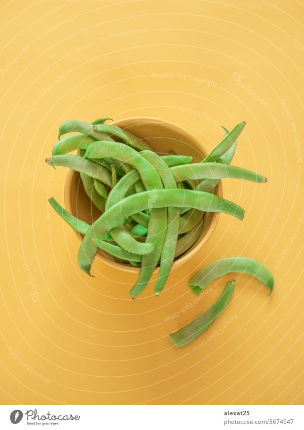 Green beans in a bowl on yellow background with copy space agriculture cuisine diet food fresh freshness green green bean group healthy ingredient legume long