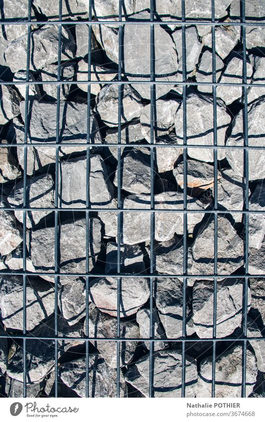 Stones and grid stone stones shadow Shadow Close-up Exterior shot Day Minerals Colour photo Gray arrangement wall Detail Wall (barrier) Arrangement