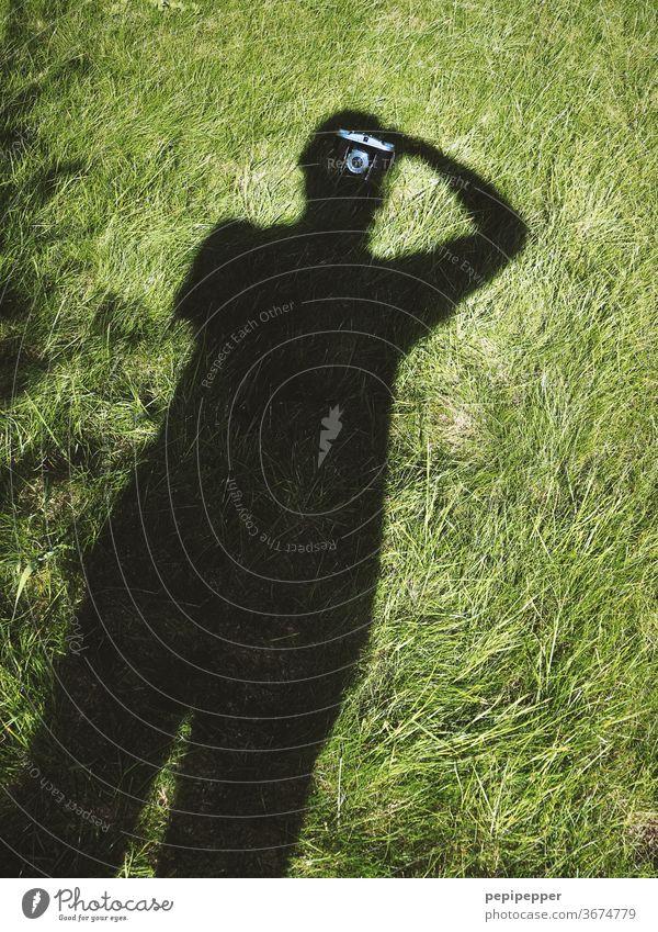 Shadow self-portrait Shadow play Dark side Self portrait Shadowy existence Silhouette Human being Exterior shot Contrast Man Take a photo Meadow Lawn camera
