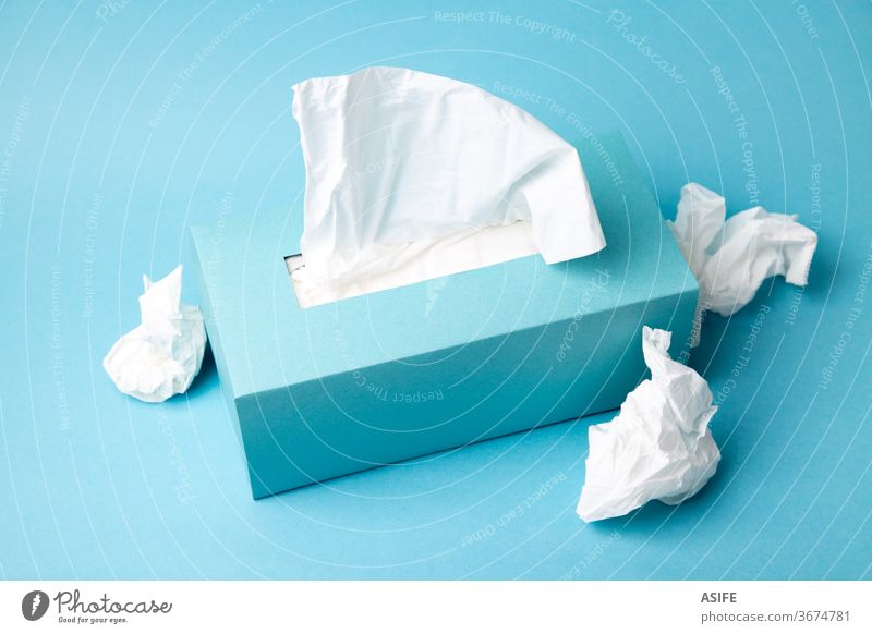 Cold and flu concept with a tissue box and crumpled tissues disposable health prevention cardboard container dispenser mockup blank space packaging facial care