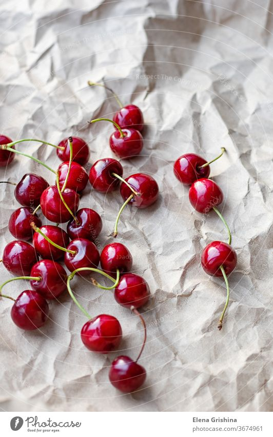 Berries of ripe cherries on a background of craft paper sweet cherry red fresh organic dessert healthy diet berry summer fruit food raw vegetarian natural