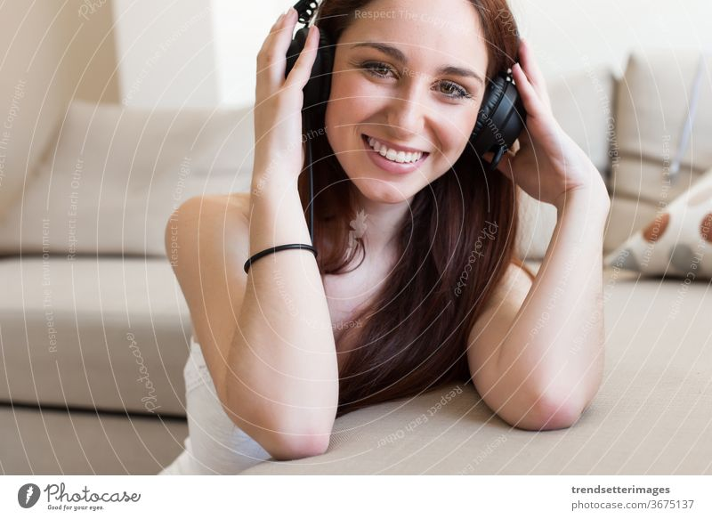 Woman with headphones woman music girl listening young beautiful background white people female pretty attractive happy portrait adult caucasian isolated smile