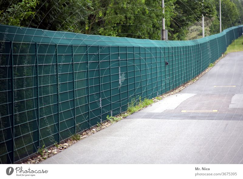 A long green fence Barrier Safety Fence cordon Captured Threat Border Freedom Protection Escape exclusion captivity Bans penned refugee camp No admittance