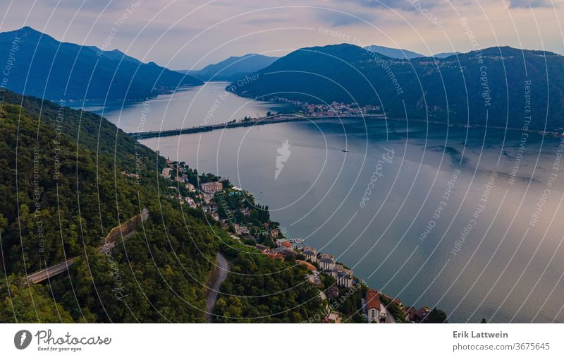 Aerial view over the Lake Lugano in Switzerland - evening view aerial alps beautiful blue city europe green lake landscape lugano mountain nature outdoor scenic
