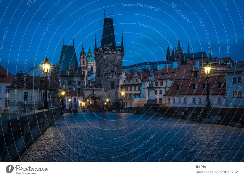 Early morning on the Charles Bridge in Prague. river city architecture bridge europe travel water castle cityscape czech town Vltava sky old swan view church