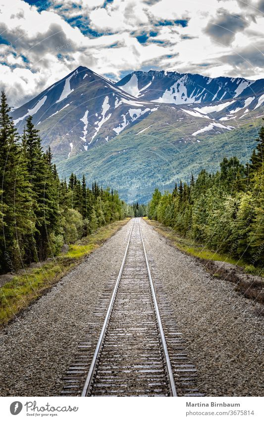 Railroad to Denali National Park, Alaska with impressive mountains journey denali railway railroad alaska national park background beautiful blue brown color