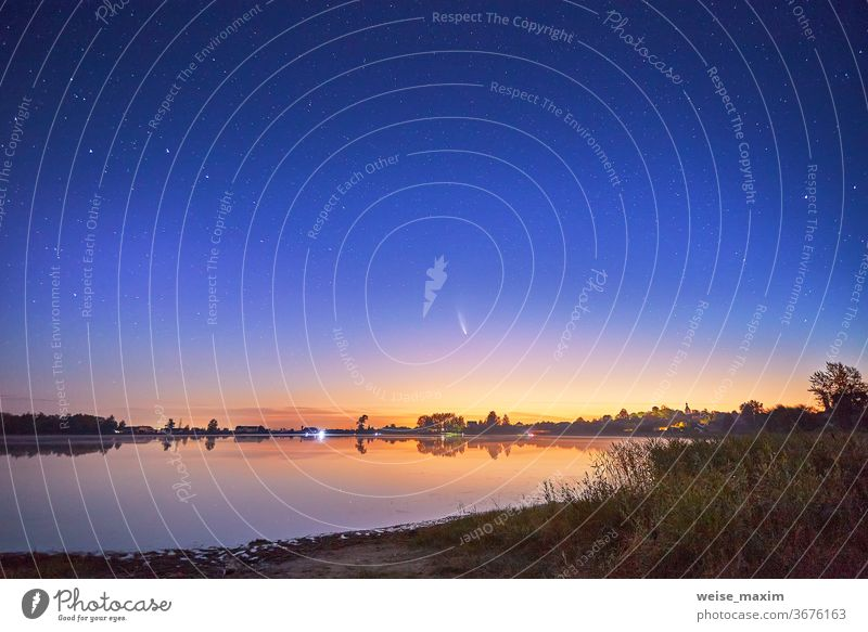 Neowise comet with light tail in night sky over lake star neowise nature landscape astronomy space water galaxy romantic meteor bright dark background beautiful