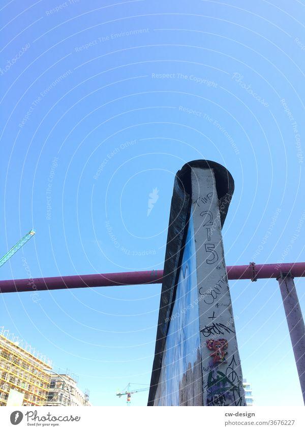 Contemporary history - Berlin Wall at Holzmarktstraße current The Wall wall demolition Building stone Traces of fomer wall masonry Blue sky Wall (barrier)