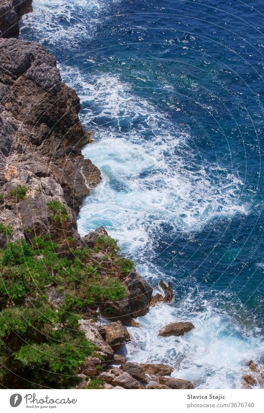 Aerial View Of A Rocky Coast water nature rock travel sea stone landscape ocean color above aerial aerial view background blue coast coastal coastline europe