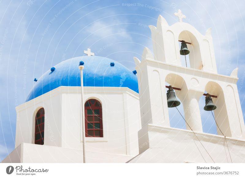 Famous beautiful Orthodox church with blue dome in Oia on Santorini island, Greece aegean architecture building caldera coast culture cyclades day destination
