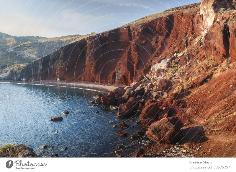 Famous Red Beach, with volcanic sand  and  rocky shoreline on Santorini island ,  Akrotiri, South Aegean, Greece aegean akrotiri background bay beach blue cliff