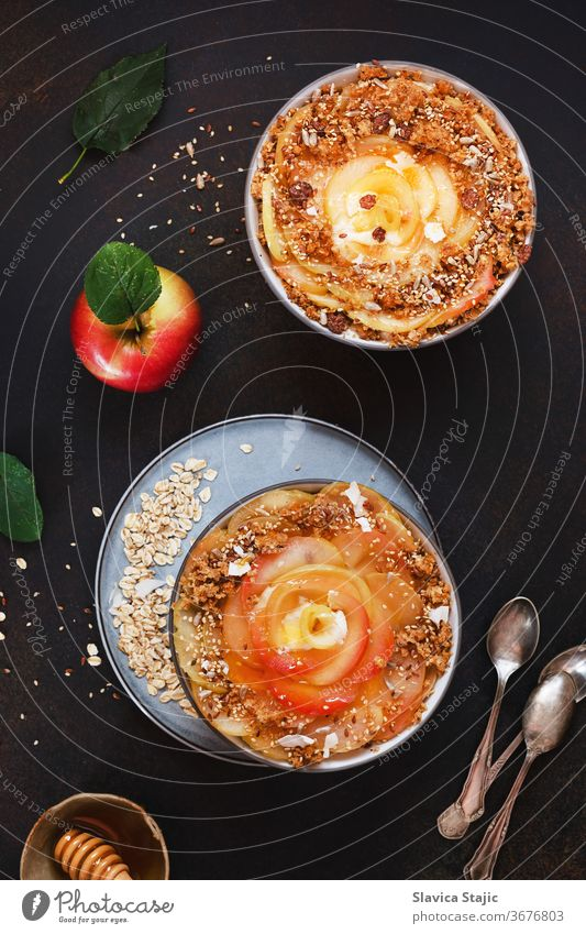 Apple cinnamon oatmeal. Sweet apples with a crunchy, crumbly cinnamon and honey topping art background bowl bran brown cereal dairy dark dessert diet dieting