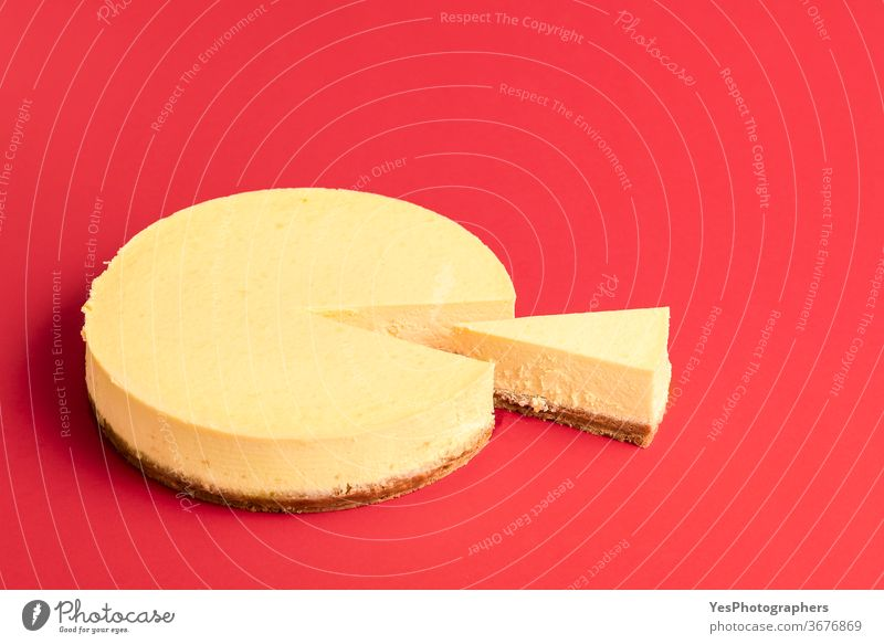 Classic cheesecake with a sliced piece. Slice of creamy cheesecake background baked bakery baking breakfast christmas classic comfort food cooking copy space