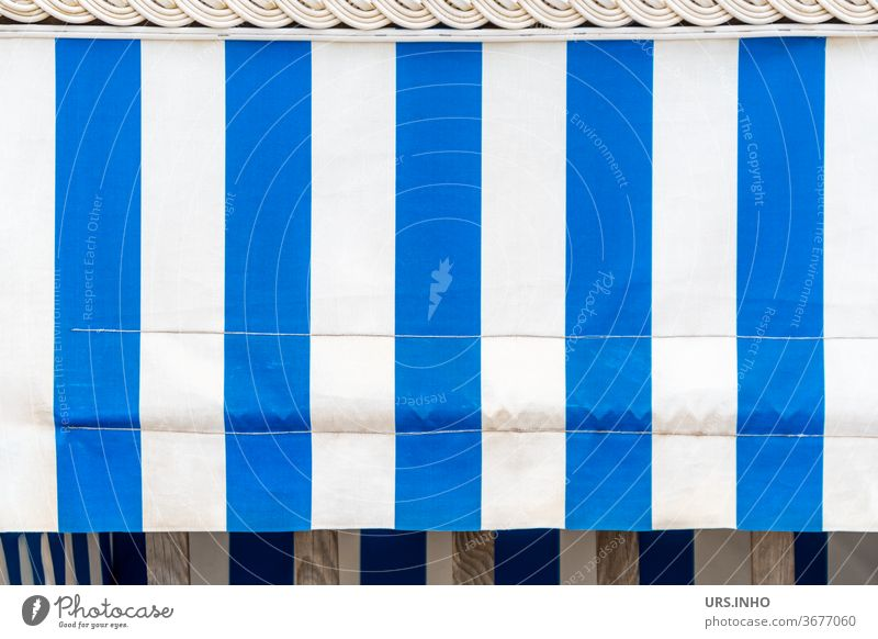 the blue and white striped sunshade on the empty beach chair hides the view Beach chair rental sun protection decorations Striped Sunshield White Blue