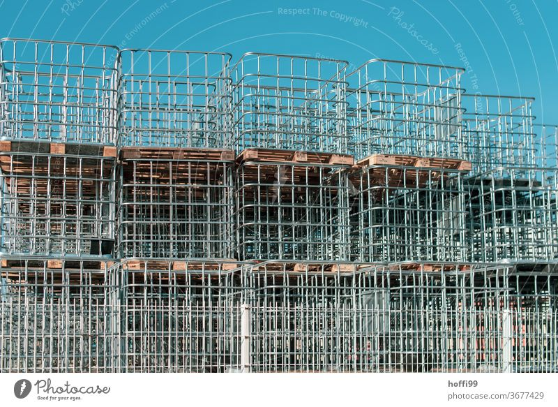 a stack of pallets with container edging Stack border logistics Transport Euro Pallet Palett Construction site Storage Logistics construction site supply
